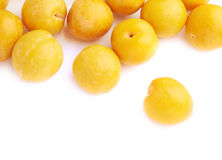 Pile of multiple yellow plums isolated Stock Photo