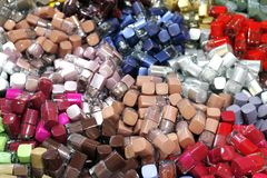 Pile of Nail Polish many for background, Abstract bottles colors of nail polish colorful, Stacks bottles of fingernail paint royalty free stock photo