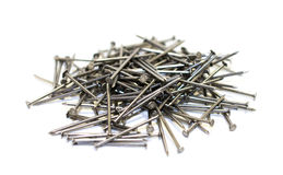 Pile of nails. Pile of iron nails on a white background isolated Stock Image
