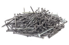 A pile of nails and screws. On white with shadow Royalty Free Stock Images