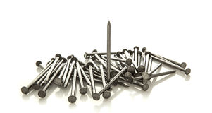 Pile of nails on white Royalty Free Stock Image