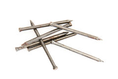 Pile of nails on white background. Pile of 7 nails on a white background Royalty Free Stock Photos