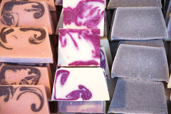 Pile of natural handmade soaps for sale. Stack of different handmade soaps on retail market Stock Photography