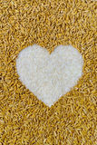 Pile of natural rice grains in heart shape.  Stock Photo