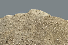 Pile of natural unsifted dirt with small pebbles and stones embedded - isolated on a blue background Royalty Free Stock Photo