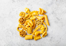 Pile of naturally colored yellow pasta with eggs Stock Photos