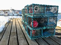 Pile of neatly placed crab traps on a dock. Ready to be used to capture crabs Royalty Free Stock Image