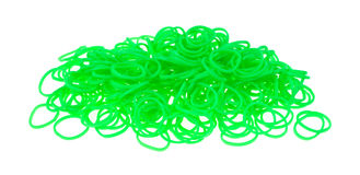 Pile of neon green loom bands Royalty Free Stock Image