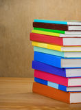 Pile of new books on wood Royalty Free Stock Photo