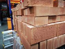 Pile of new bricks for construction. Group, material. Pile of new bricks for construction. Group, material on a store royalty free stock image