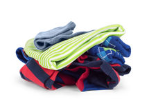 Pile of new children's clothing isolated on white. Background Stock Photos