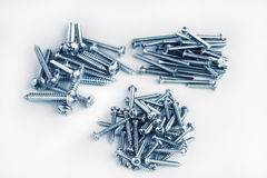Pile of new different screws toned Stock Photography