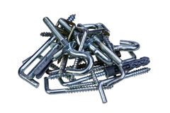 Pile of new hooks with dowels isolated on white background Royalty Free Stock Images