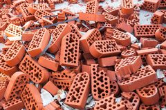 Pile of new intact and beaten bricks Stock Photography