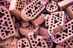 Pile of new intact and beaten bricks Royalty Free Stock Images