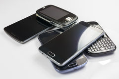 Pile of new and old mobile phones Stock Photography