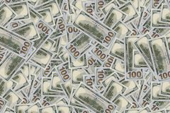 Pile of new and old one hundred dollar bills bills. Dollar texture. Dollars background. several million dollars. thousands of hundred-dollar bills on the floor stock image