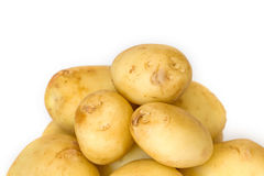 Pile of new potatoes on white background close up Royalty Free Stock Photography