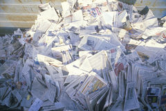 A pile of newspaper waiting for recycling in a bin at the Santa Monica Community Center, CA Stock Images