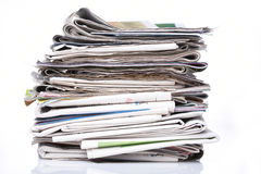 Pile of newspapers. Stack of newspapers on white background Stock Images