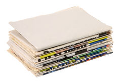 Pile of newspapers. Blank newspaper on a pile of other newspapers royalty free stock photography