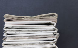 Pile of newspapers. On black background stock photo