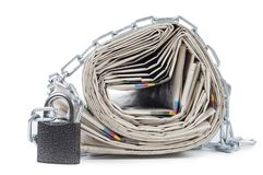 Pile of newspapers with chains stock images