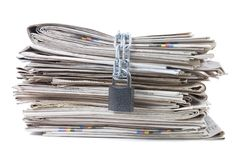Pile of newspapers with chains Stock Photos