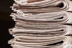 Pile of newspapers closeup Royalty Free Stock Images