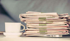 Pile of newspapers and coffee Royalty Free Stock Images