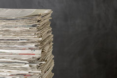 Pile of newspapers on a dark background Royalty Free Stock Image