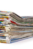 A pile of newspapers isolated. On a white background Royalty Free Stock Photos