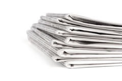A pile of newspapers. Isolated on white background royalty free stock photos