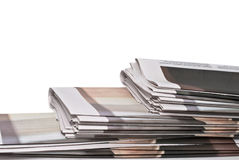 Pile of newspapers on white background Stock Image