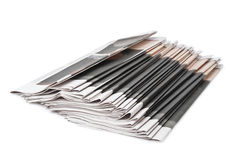 Pile of newspapers on white background Royalty Free Stock Photos