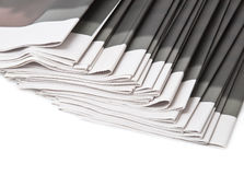 Pile of newspapers on white background Stock Photos