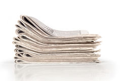 A pile of newspapers. On white background Royalty Free Stock Photos