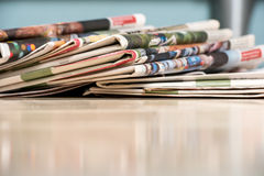 Pile of newspapers. On wood table Stock Photos