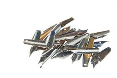 Pile of nibs. Pile of vintage fountain pen nibs at white background royalty free stock photo