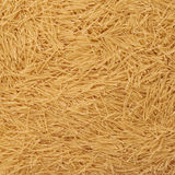 Pile of noodles yellow pasta as abstract background Stock Photography