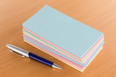Pile of Note Pads with Pen Royalty Free Stock Photo