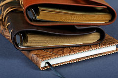 Pile of notebooks in leather covers Royalty Free Stock Photos