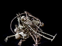 Pile-O-Skeletons. A pile of Halloween decoration skeletons on pure black background Stock Photography