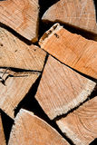 Pile of oak wooden logs stacked for firewood. Vertical closeup Stock Image