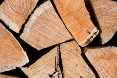 Pile of oak wooden logs stacked for firewood. Horizontal closeup Stock Photos
