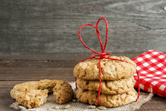 Pile of oat cookies tied with heart shaped red ribbon Royalty Free Stock Photo