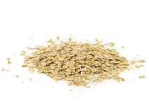 Pile of oatmeal isolated on white background.  royalty free stock photos