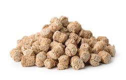 Pile of oats bran pellets Stock Image