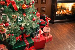 Free Pile Of Christmas Gifts Close-up Under The Christmas Tree. Red And Green Presents Royalty Free Stock Photography - 104328787