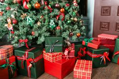 Free Pile Of Christmas Gifts Close-up Under The Christmas Tree. Red And Green Presents Stock Photos - 104329203